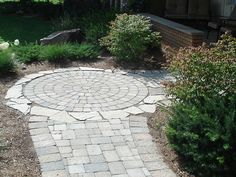 Mixing natural flagstone with interlock pavers.