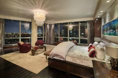 This luxurious bedroom is situated high above the city. Windows on three sides of the room provide a glorious view. Source: http://www.zillow.com/digs/Home-Stratosphere-boards/Luxury-Bedrooms/
