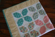 Flower Girl Quilt using Bright Sun by Sherri & Chelsi of A Quilting Life. Free instructions on the Moda Bake Shop blog.