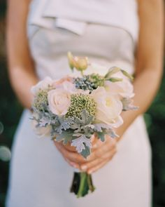 The ladies at this Eva Amurri and Kyle Martino's Charleston, South Carolina, wedding carried petite posies designed by Blossoms Events, made up of garden roses, trachelium, lisianthus, and dusty miller.