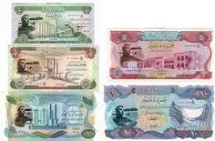 Economy: This photo is of the Iraqi currency called the Iraqi Dinar. It is the main currency used in Iraq.  1 dollar equals 1136.31 Iraqi Dinar. The GPD in Iraq is only 7,100 which isn't very much compared to the United States which is 53,142 U.S. dollars.