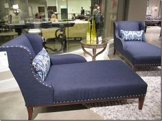 Midnight blue chaise lounge with nailhead trim from Hooker Furniture.