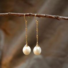 White pearl earrings - dangles on ear hooks with gold chain - bridal or everyday…