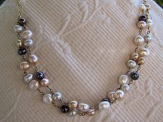 """A double strand necklace of lovely multi-colored freshwater pearls. It is 19 1/2"""" in length and is adjustable to shorter lengths. Gorgeous."""
