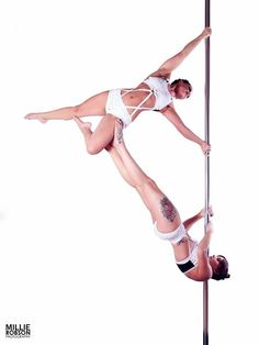 "Pole Picture of the Day: Submitted by @Karen Gaunt from Danse Vivante Castle Vale in the ""Twisty Terminator"" #BadKittyPride #BKPPOD #PoleDoubles  Submit your photos here: www.badkitty.com/submit  Karen is wearing the PoleFit® Rockstar Top: http://www.badkitty.com/rockstar-pole-dance-top.html?___store=default"