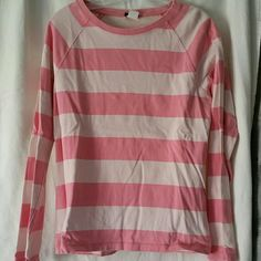 Long sleeve pink striped tee J.Crew 100% cotton thicker/heavy striped tee. Darker pink and light pink stripes. Collar/top of shoulders have the worn/ faded style look. Great condition, never worn. J. Crew Tops Tees - Long Sleeve