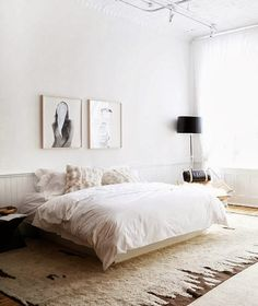 I love the two large picture frames. the whole room to clean and simple but yet warm and cozy. That my kinda room.