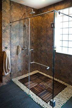 Hipster House Masculine shower. Use shower tray with built in PVC center drain, add river rocks and wooden shower pieces to bottom