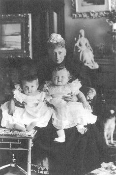 A rare photo of Baby Olga with a cousin and another great-grandmother, Queen Louise of Denmark, in 1897. Olga is on the right.