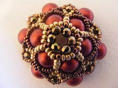 Free tutorial with photos to make this beaded bead. Not in English but clear enough to follow.