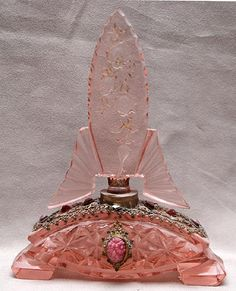 Pink Czech cut glass perfume bottle,  gilt metal with jewels and intaglio stopper
