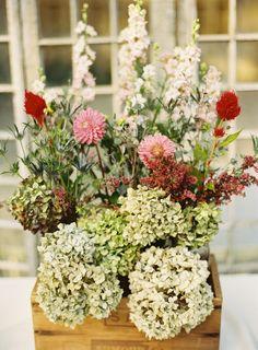 beautiful wedding floral arrangement for centerpiece in wooden box #weddingdecor #weddingreception #weddingchicks http://www.weddingchicks.com/2014/01/29/thrift-savvy-wedding