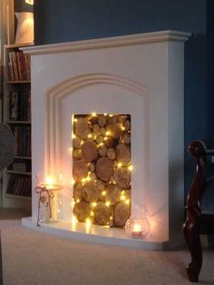 25 Cozy Fairy Lights Ideas For Living Room DIY and crafts - fireplace decoration,fireplace decor ideas,fireplace decorations Fake Fireplace, Bedroom Fireplace, Fireplace Mantels, Fireplace Ideas, Unused Fireplace, Fireplace Lighting, Decorative Fireplace, Cabin Fireplace, Fireplace Seating