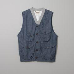 Universal Works Angler Waistcoat made with 100% cotton chambray and finished with 100% cotton rib. $145 at Lark Universal Works, Color Studies, Boyfriend Material, Chambray, Work Wear, Vests, Cotton, Jackets, Blue