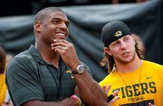 Former Missouri player Michael Sam talks with former teammate T.J. Moe. - L.G. Patterson/AP