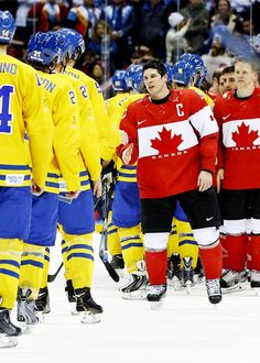 Always respectful yet understandably resentful: Team Canada and Team Sweden go through the ritualistic roundup to shake hands with rivals as a resolution to a hard-fought game. #Sochi2014