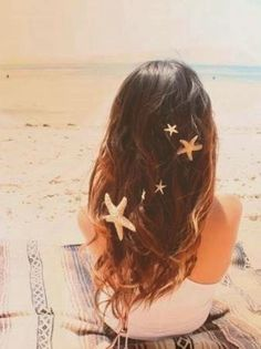Beachy brunette waves with starfish hairclips.