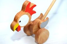 Wooden eco-friendly push toy - Chicken. The item is a great gift idea. This beautiful wooden chicken is completelly handmade. It is crafted of eco wood, durable and safe for your child, because colored with safe acrylic paints and covered with non-toxic varnish. - - - - - - - - - - -