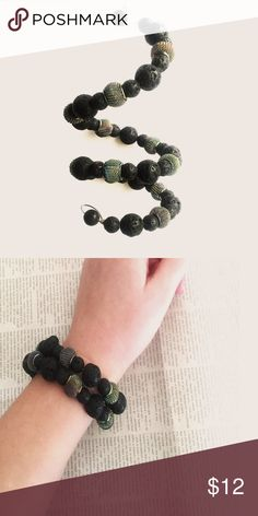Brand New Layered Charcoal Bracelet Brand New with tags. Handmade by me 😍 Lifetime Warranty! Handmade for the edgy, vibrant and unique. This everyday bracelet is created with unique charcoal like gemstones, accented with multi-colored metal spacers. Nothing less than uniquely fashionable.    Product Detail + metal wrap bracelet  + one size fits all + adjustable gunmetal wire + charcoal gems + silver-plated metal MinCali Jewelry Bracelets