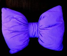 Make this out of a pillow and some extra cloth of the same color!