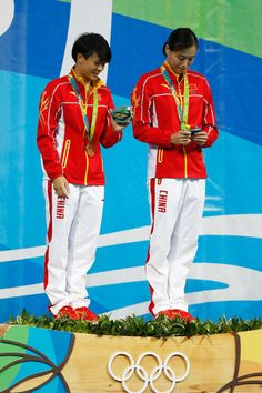 Gold medalists Tingmao Shi and Minxia Wu of China pose on the podium during the medal ceremony for the Women's Diving Synchronised 3m Springboard Final on Day 2 of the Rio 2016 Olympic Games at Maria Lenk Aquatics Centre on August 7, 2016 in Rio de Janeiro, Brazil.