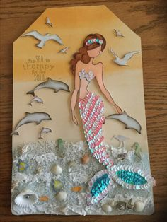I created this tag using Sea Sallie stamp by Julie Nutting