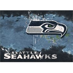 """Seattle Seahawks Rug Team Fade Mat. Make a statement in any room with this large floor area rug. This rug measures 3'10"""""""" x 5'4"""""""" and will fit well with any decor. This Seahawks rug features the team"""