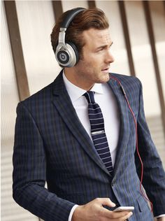 As if your mixed patterns didn't already make you look like an ass, you had to top it off with those headphones? Leave this out of your portfolio, dude.