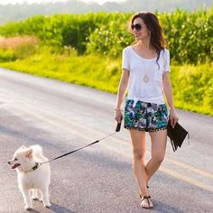 Going for a stroll with my furry friend in floral pom pom shorts and a basic white tee.