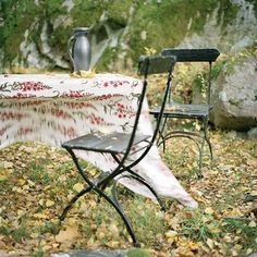 reading in the garden.: and some very pretty french cafe chairs and table.