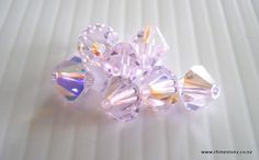 Rosaline AB 4mm and 6mm #Swarovski Bicones - a great colour for a cool pink. http://rhinestonz.co.nz/category/crystal-beads