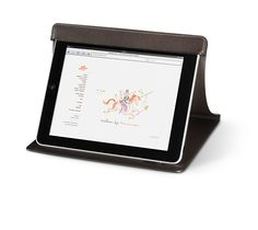 """HigHtecH Leather work station for iPad® allows you to prop up your device up for working or viewing media.Functions as a cover to protect your device in transit.Made of dark brown evergrain calfskin.Measures 10.2"""" x 8.5"""".  iPad® is owned by Apple Inc.<br><br><span style=""""color: #F60;"""">This item may have a shipping delay of 1-3 days.</span><br><br>"""