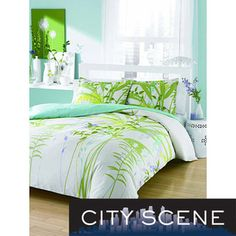 @Overstock - This cotton floral duvet cover set made by City Scene has a whimsical green floral pattern on a crisp white background for an eye-catching look. The set has a 150 thread count and the duvet cover has a button closure. Pillow shams are also included.http://www.overstock.com/Bedding-Bath/City-Scene-Mixed-Floral-3-Piece-Duvet-Cover-Set/6735015/product.html?CID=214117 $49.99