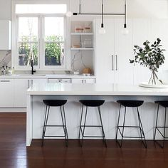 Black kitchen faucets, all white kitchen, kitchen pendants, kitchen lightin White Kitchen Island, All White Kitchen, Black Kitchens, New Kitchen, Home Kitchens, Modern Kitchens, Kitchen Mixer, Kitchen Sink, Kitchen Cabinets