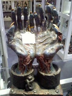 Chained #Zombie arms that can hold your book for you!