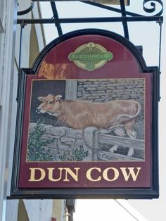 Dun Cow pub sign Quite an attractive beast.