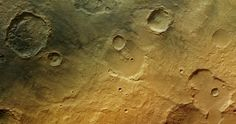 In the ancient cratered southern highlands of Mars, the faint traces of a wet past are seen in the form of channels (lower centre), fluidised debris around craters (bottom right) and blocks of eroded sediments (top left). Volcanic activity may have deposited the fine dusting of dark material visible in the top left.