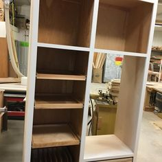 A custom double oven cabinet storage above 3 pull out shelves and a pull out cookie sheet holder on the bottom to the left of the cabinet#customwoodworking #kitchencabinets #hardwoods #bathroomvanity #classicwood #entertainmentcenters #lnk via ClassicWoodLincoln.com