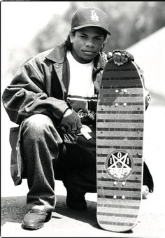 Eazy-E shows off his skate deck in Los Angeles, CA