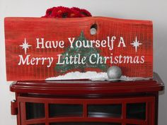 Have Yourself A Merry Little Christmas (Red w/ tree) Red Stain Background, White Letters, Green tree w/ Sparkles and glistening snow. SawTooth hanger, Approx. 20Lx8.5Hx.5W