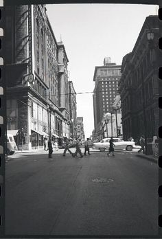 Downtown street scene at Locust and Olive, including the Old Post Office at 815 Olive Street and Scruggs, Vandervoort and Barney. This photo was probably taken to promote efforts by the Landmarks Association of St. Louis to save the Old Post Office from demolition. Photograph by Henry T. (Mac) Mizuki, 1960. Mac Mizuki Photography Studio Collection, Missouri History Museum. | collections.mohistory.org