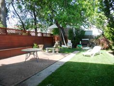 Private Backyard with Bench Seating and BBQ Grill Pit