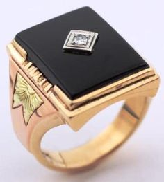 ELVIS' JEWELRY: Black Onyx and diamond ring with 24 kt gold TCB engraved on the sides.