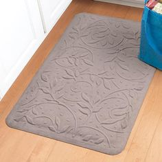 Pressure-relieving mat eases the strain of standing on hard floors.