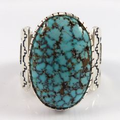 "Sterling Silver Ring with Overlaid Weather Pattern Designs and set with Natural Kingman Spiderweb Turquoise from Arizona. Ring Size: 11 .625"" Stone Width, .875"" Stone Height .375"" Band Width"