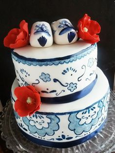 Second Generation Cake Design ~ Delft Blue Hand painted cake with red tulips and ceramic clogs. #Dutch #Cake