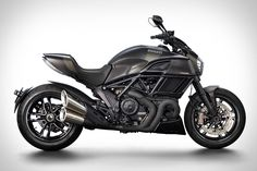 Powered by a 162 hp Testastretta engine, the Ducati Diavel Carbon Motorcycle is a nice compromise between street cruiser and race-ready superbike. Thanks to the use of composite materials and machined aluminum components, the bike has a dry weight of...