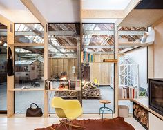 Classic-Eames-Rocker-sits-in-front-of-the-fireplace-inside-the-home-office