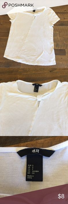 Fashionable cream white top from H&M! Cream white too with a unique, but classy design! Perfect under a blazer or with a maxi skirt! There is a super tiny tear on the top right back of the shoulder - looks like a hanger tear. However, it is barely noticeable especially if this shirt is used for layering. H&M Tops Tees - Short Sleeve