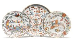THREE EUROPEAN DECORATED DISHES QING DYNASTY, 18TH CENTURY one decorated with a phoenix amongst flowering and fruiting branches, the other with figures in a landscape, and the third with mythical beasts amongst floral branches